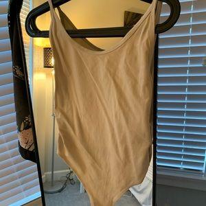 TNA thong body suit size medium beige